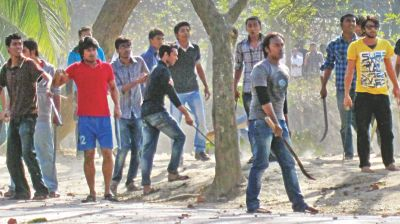 Activists of Bangladesh Chhatra League, a pro-Awami League student organisation, of Jahangirnagar University brandish sharp weapons and iron rods on the campus during a clash between the organisation's AFM Kamal Uddin Hall and Bangabandhu Sheikh Mujibur Rahman Hall units yesterday